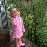my sisters grandchild, eating Saskatoon berries from the tree beside my deck.